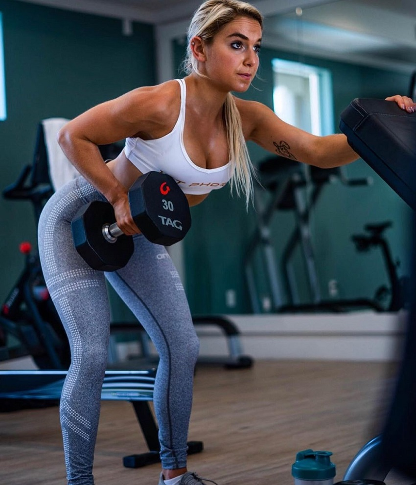 Sarah Strauss doing dumbbell rows in the gym