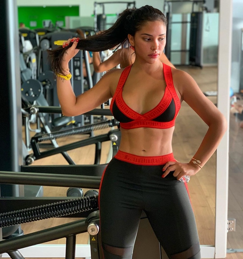 Ana Paula Saenz posing in the gym looking fit and lean