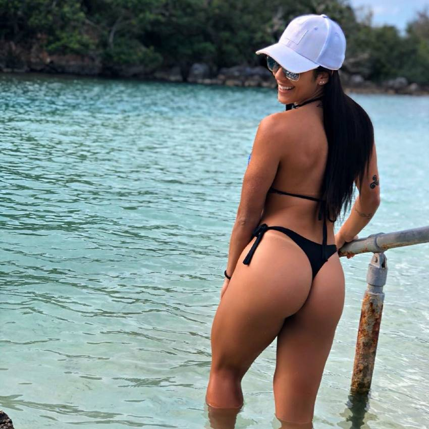 Ananda Nogueira posing by the river in her bikini, looking curvy and fit