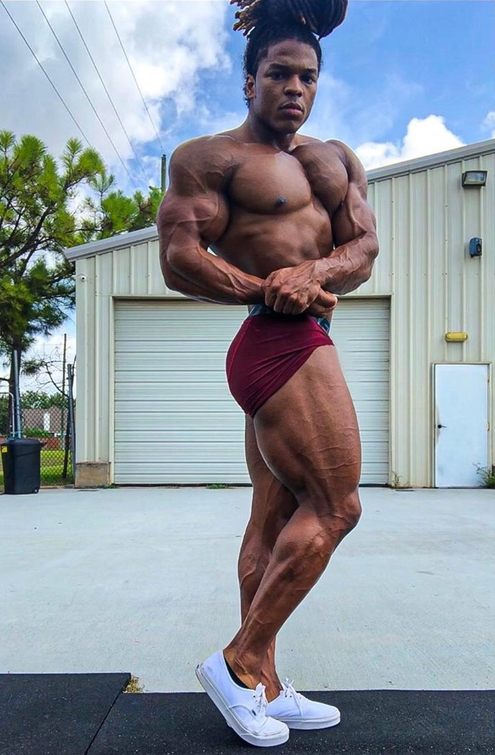 Jay Coss doing a side chest pose looking lean and fit