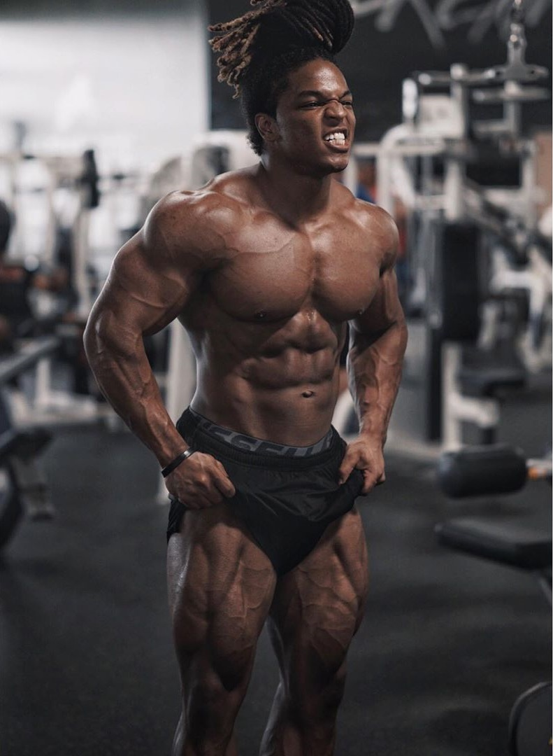 Jay Coss flexing his amazing physique in the gym
