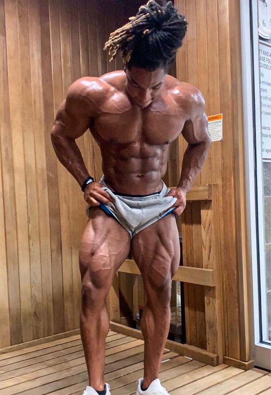 Jay Coss flexing his shredded legs