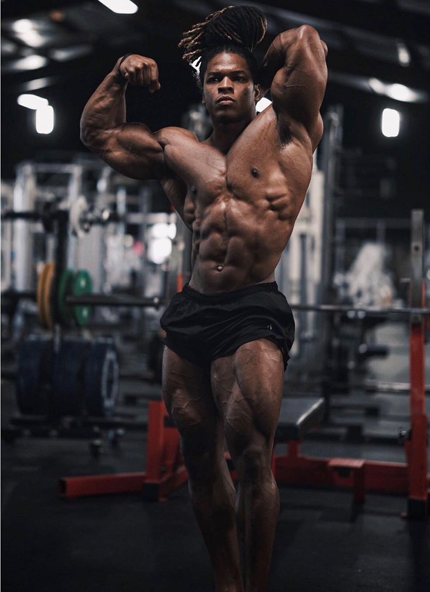 Jay Coss flexing his ripped physique for the ohoto