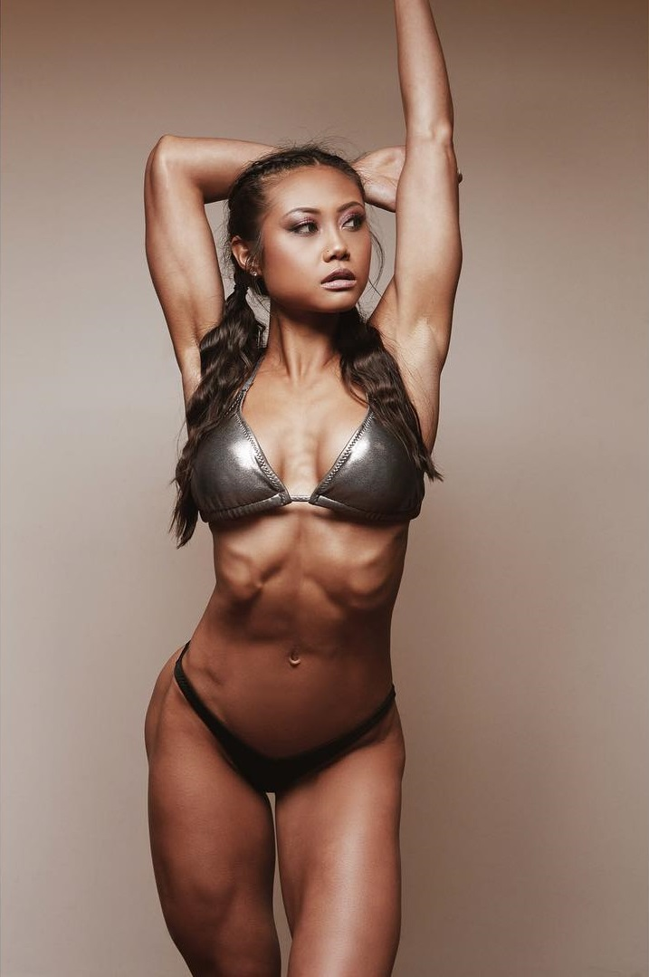 Jayne Lo posing in a silver bikini looking fit and lean