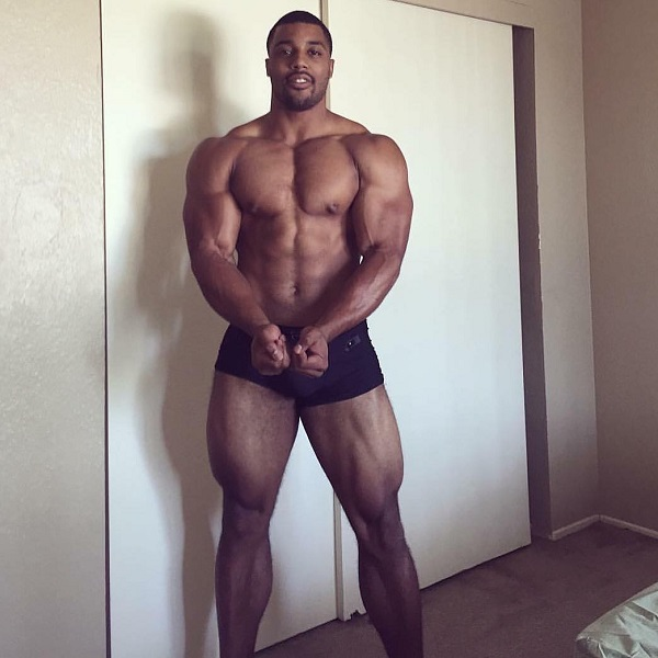 Mark White flexing shirtless looking strong and ripped