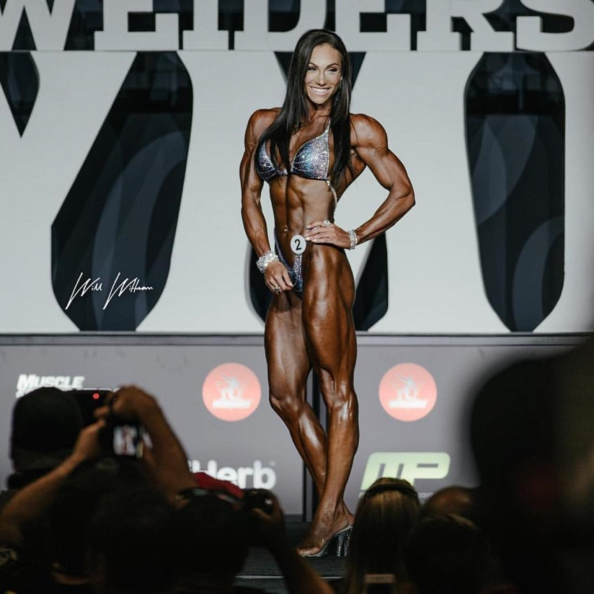 Melissa Bumstead posing on the Olympia Figure stage