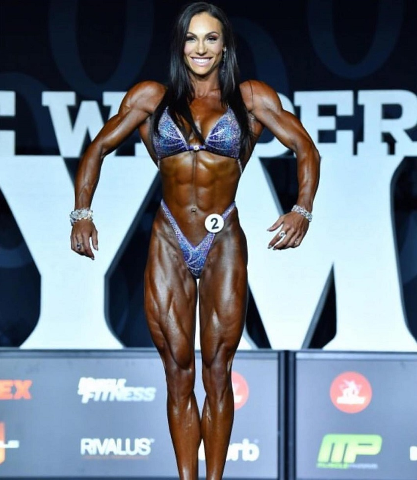 Melissa Bumstead posing on the Joe Weider's Olympia stage
