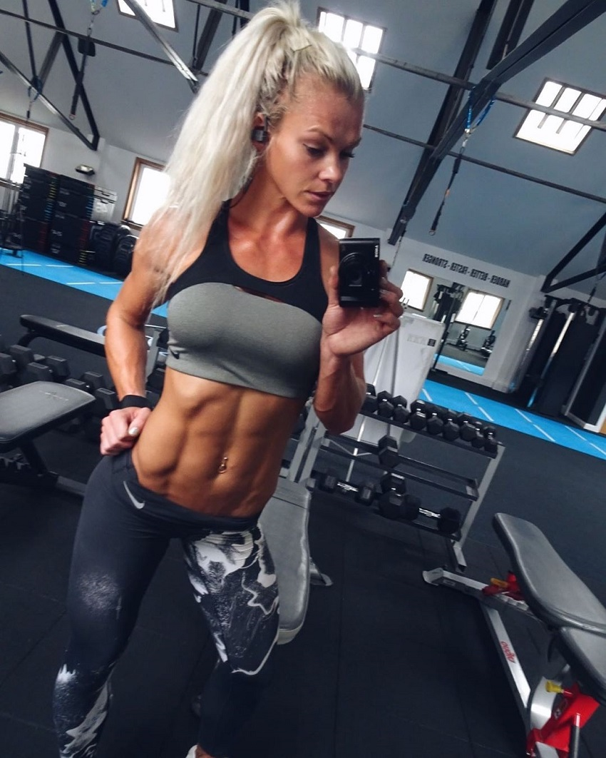 Sarah Holden taking a selfie of her bulging abs