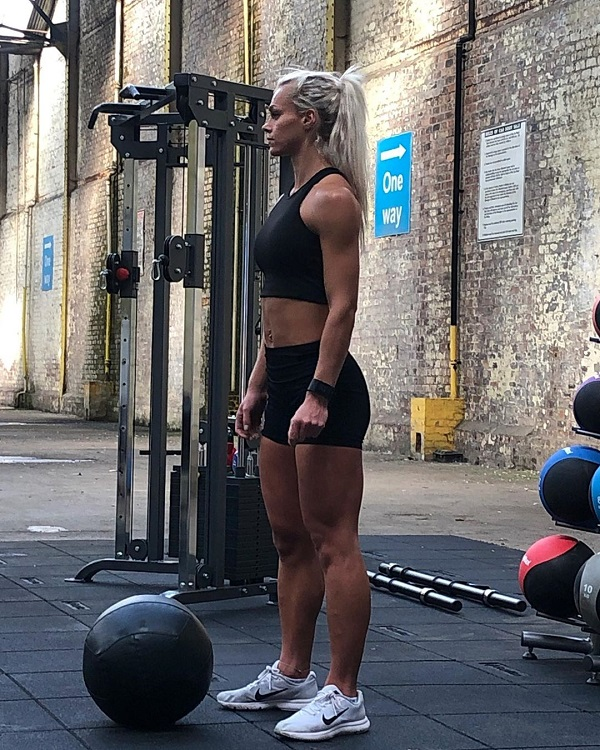 Sarah Holden standing in a gym looking fit and strong