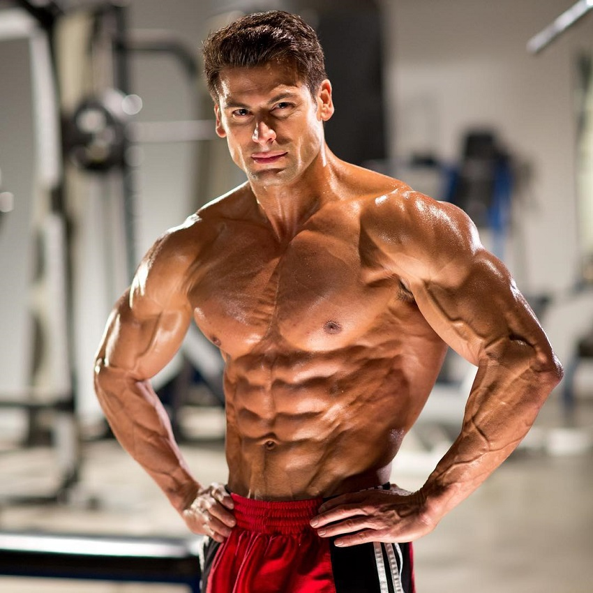 TJ Hoban posing shirtless in a professional fitness photo shoot