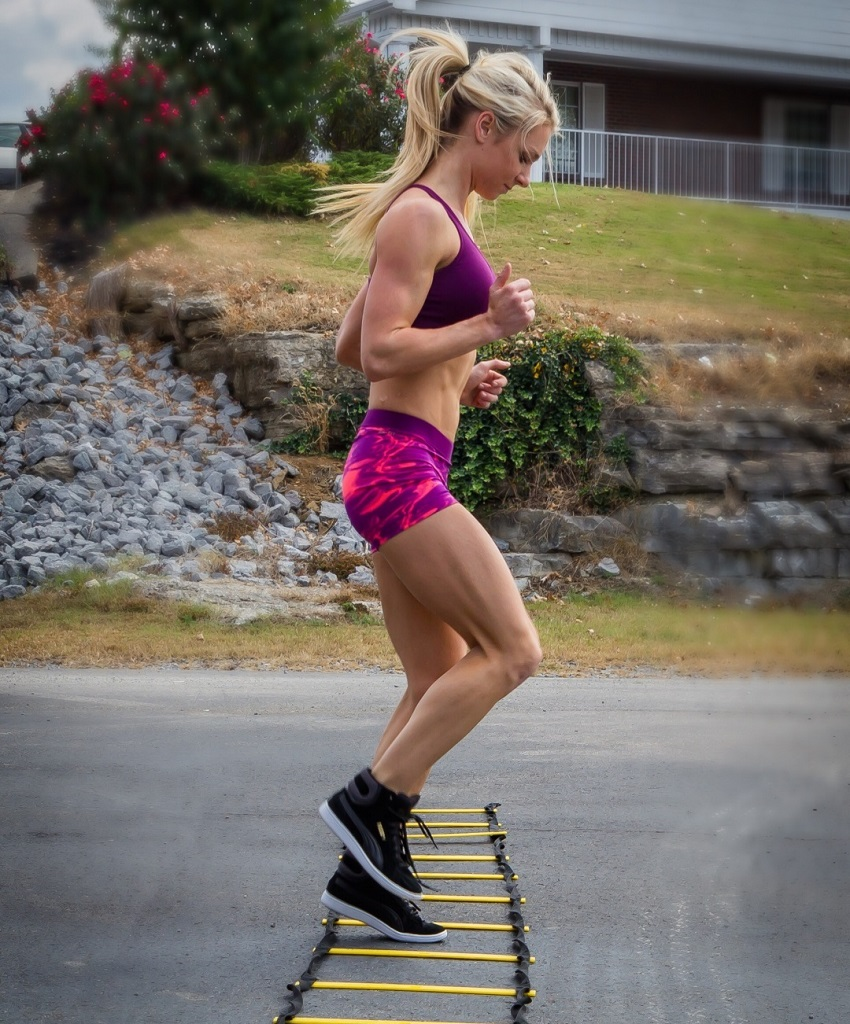 Whitney Wiser running outdoors looking fit and lean