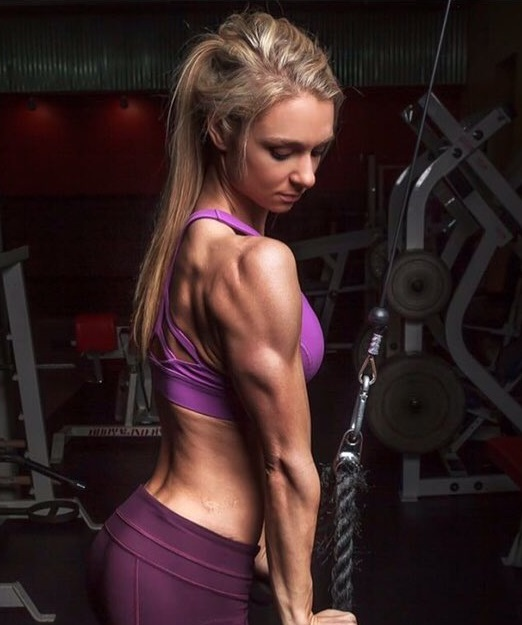 Whitney Wiser training triceps in the gym
