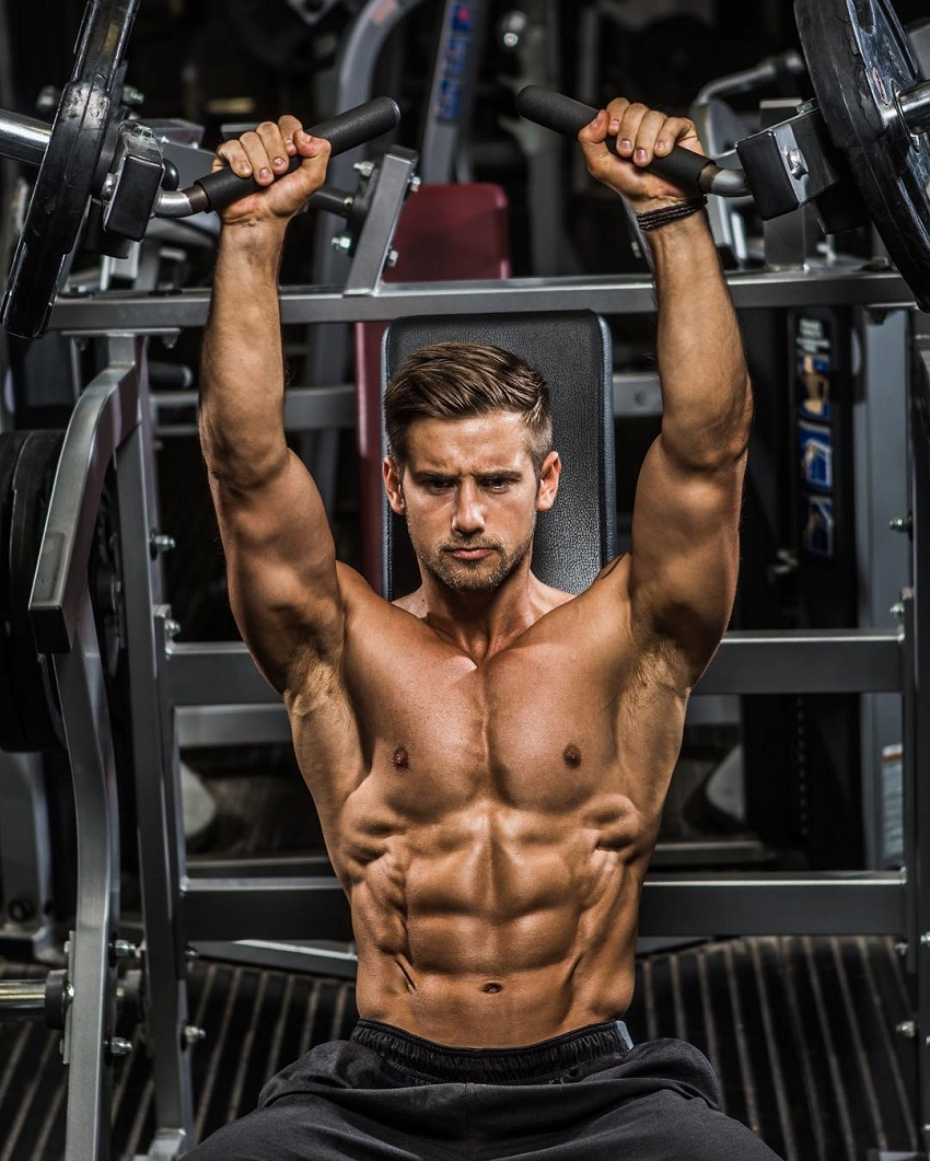 Alex Crockford training shirtless in the gym looking ripped