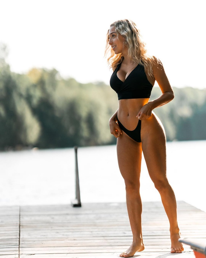 Cath Bastien posing outdoors looking lean and fit