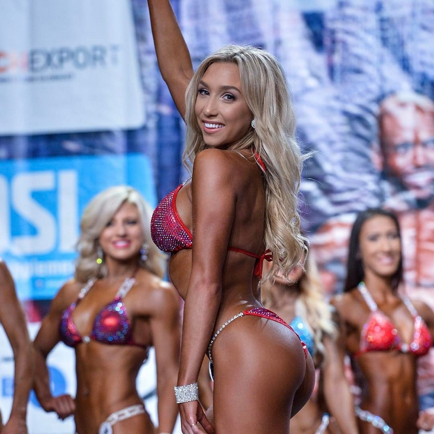 Cath Bastien posing on the bikini stage