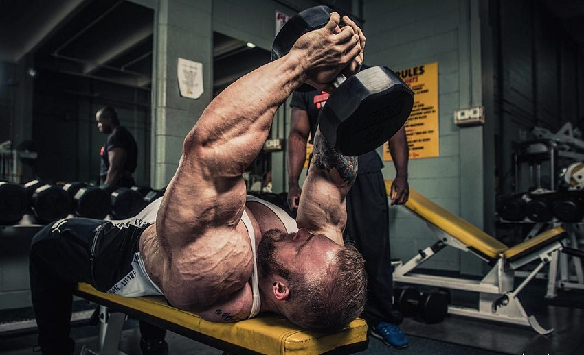 Iain Valliere training his lats lying on a bench