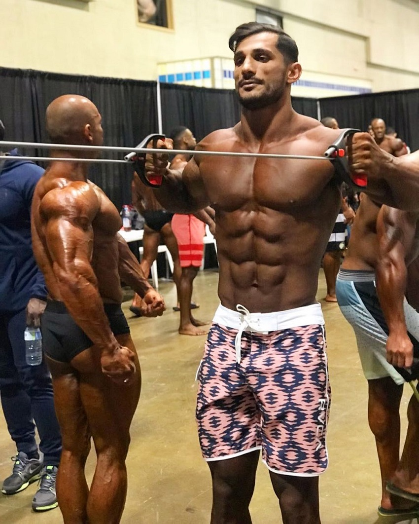 Akbar Sarbaz warming up in the backstage during a bodybuilding show