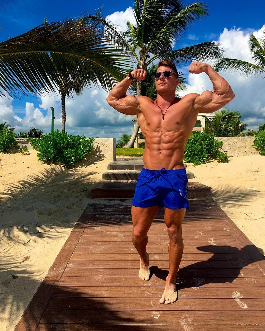 Bryan McCormick flexing his shredded muscles