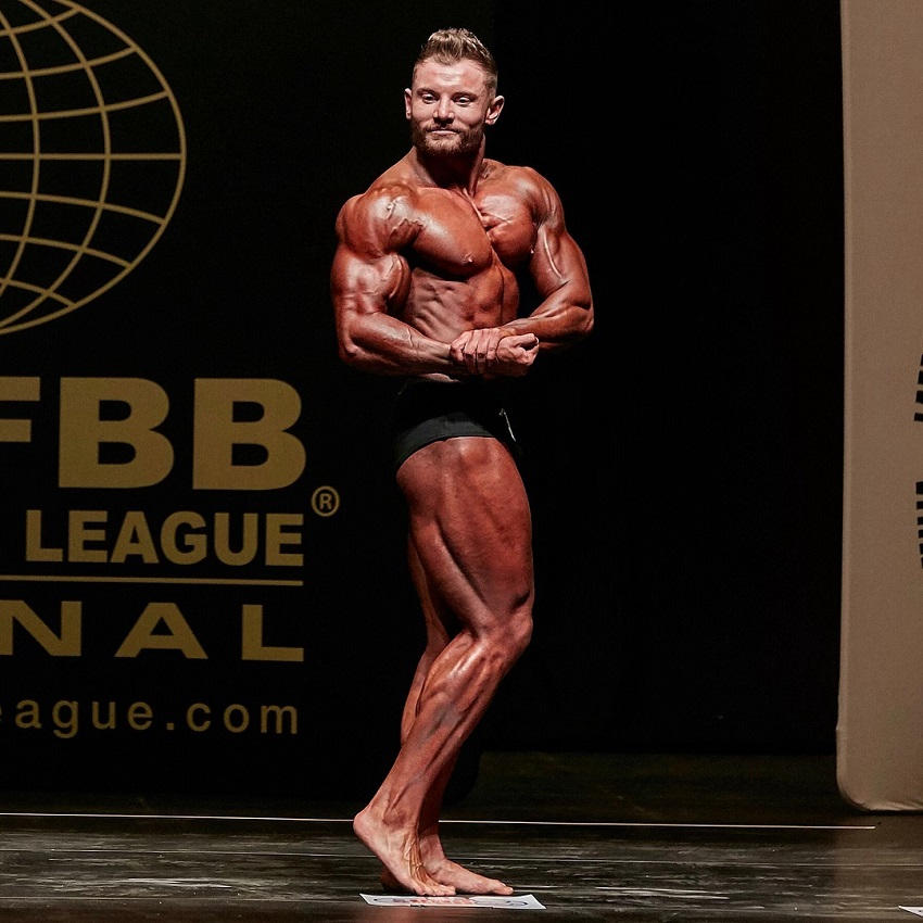 Luke Hulme flexing side chest