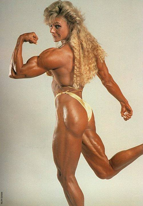 Sandy Riddell flexing her biceps