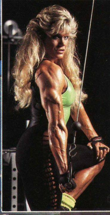 Sandy Riddell flexing her ripped triceps