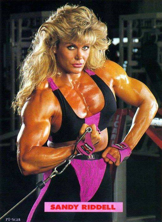 Sandy Riddell posing in a bodybuilding photo shoot