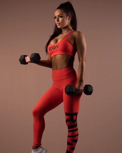 Tia Christofi doing dumbbell curls