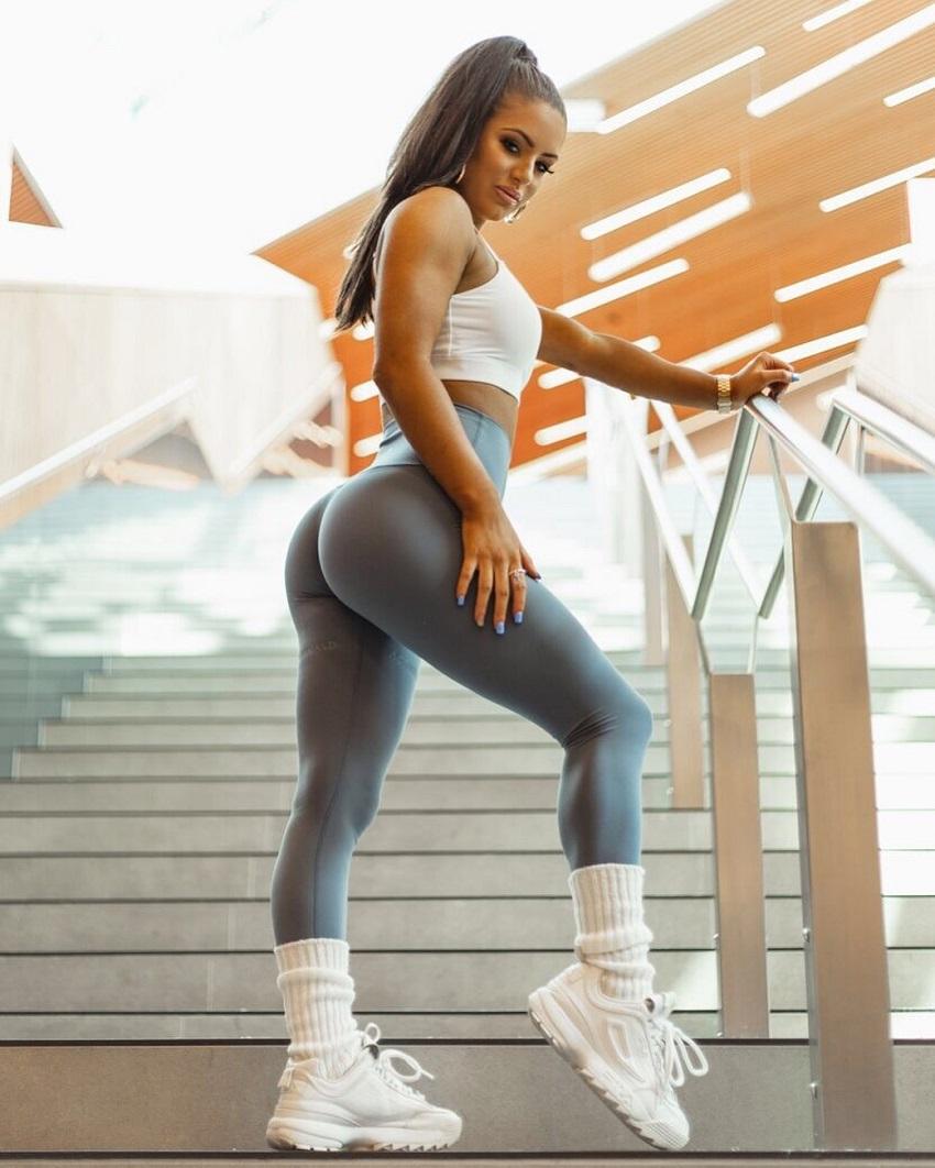 Tia Christofi posing in grey leggings