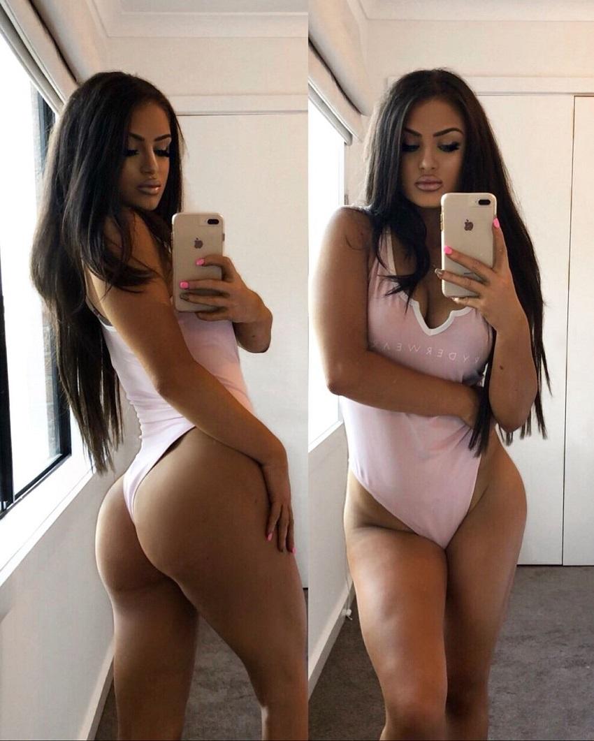 Tia Christofi taking a selfie of her curvaceous body