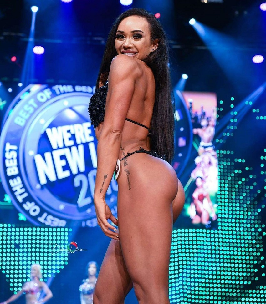 Brooke Wood showcasing her glutes in a fitness competition