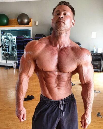 Dan Mazzola posing shirtless looking aesthetic and ripped