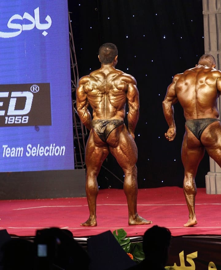 Majid Jameh Bozorg preparing to do a rear lat spread on the bodybuilding stage