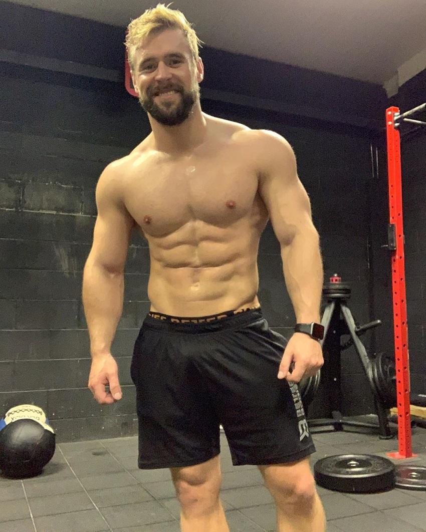 Ben Mudge flexing shirtless