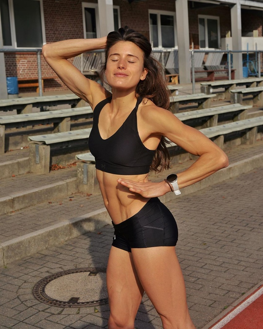 Imke Salander posing on the track field looking awesome and fit