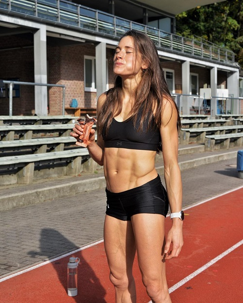 Imke Salander posing on the track field looking lean and athletic.