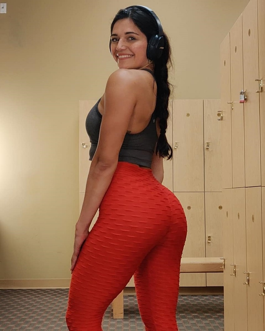 Annabel DaSilva showcasing her curvy figure in red leggings