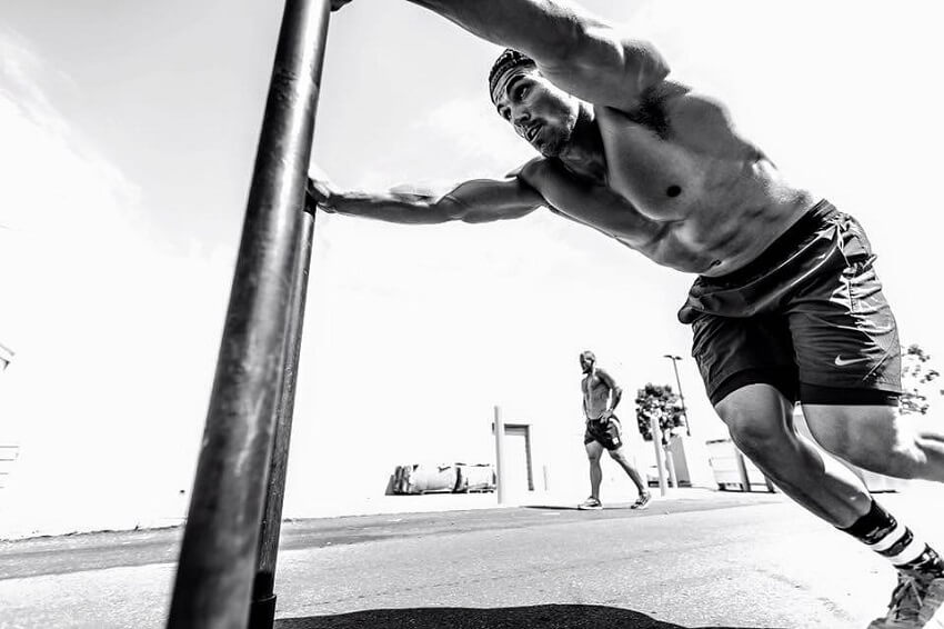 Garret Fisher training shirtless for CrossFit outdoors