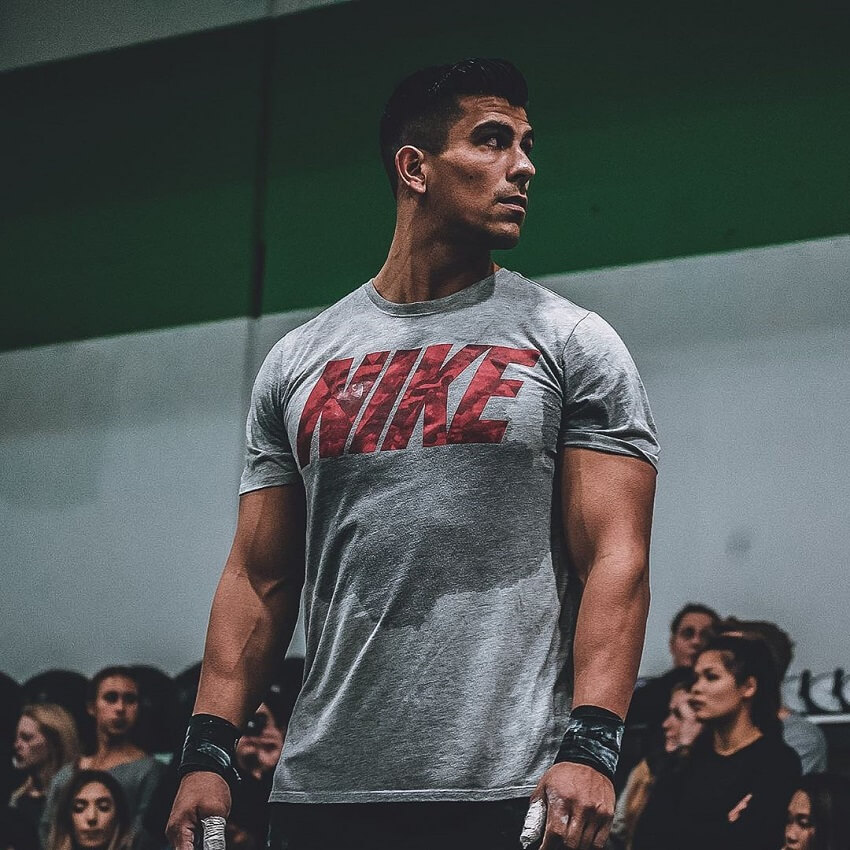 Garret Fisher in a Nike T shirt looking muscular and ripped