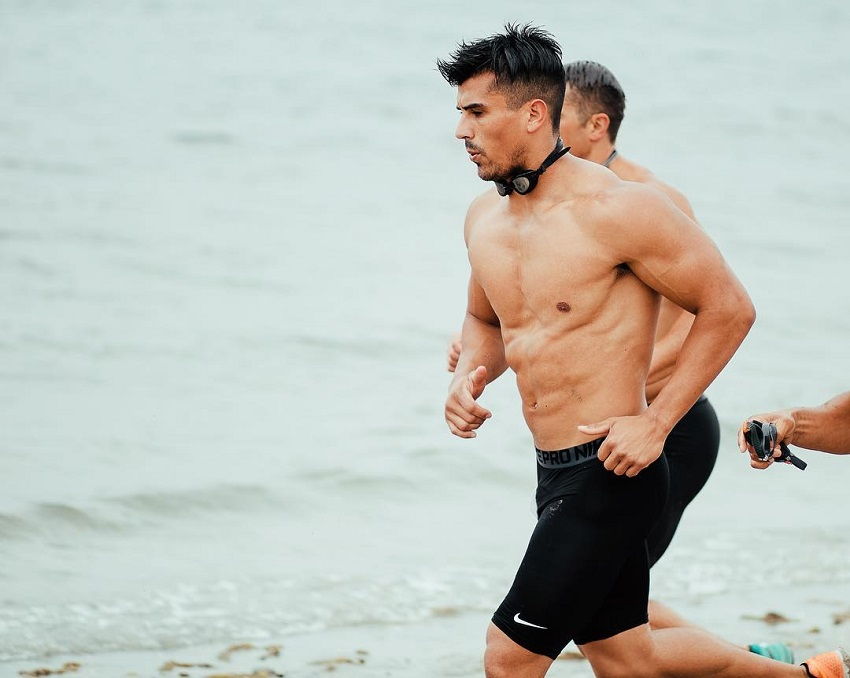 Garret Fisher running by the sea