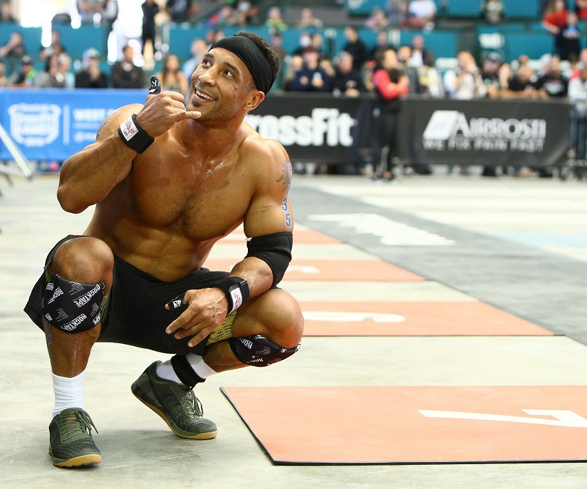 Neal Maddox shirtless in crouch position during a CrossFit contest