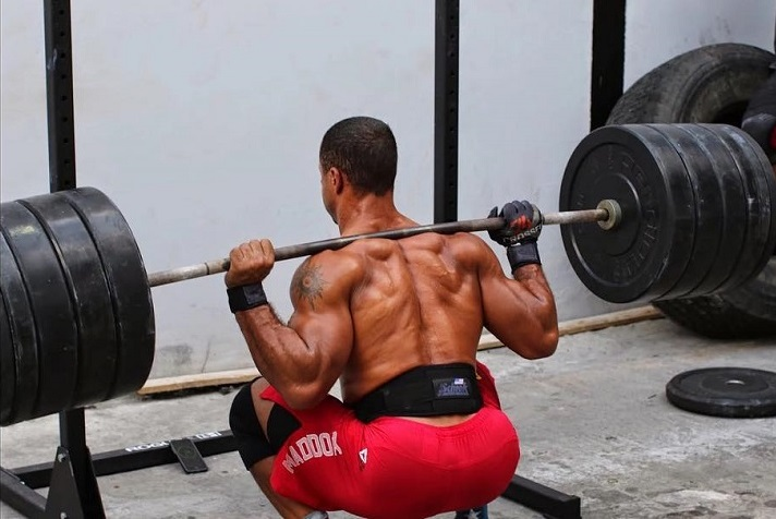Neal Maddox doing squats