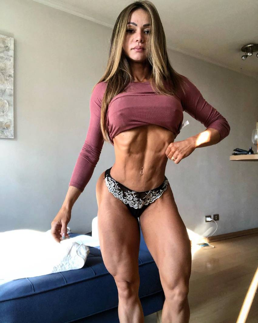 Susana Rodriguez showcasing her ripped figure for the photo