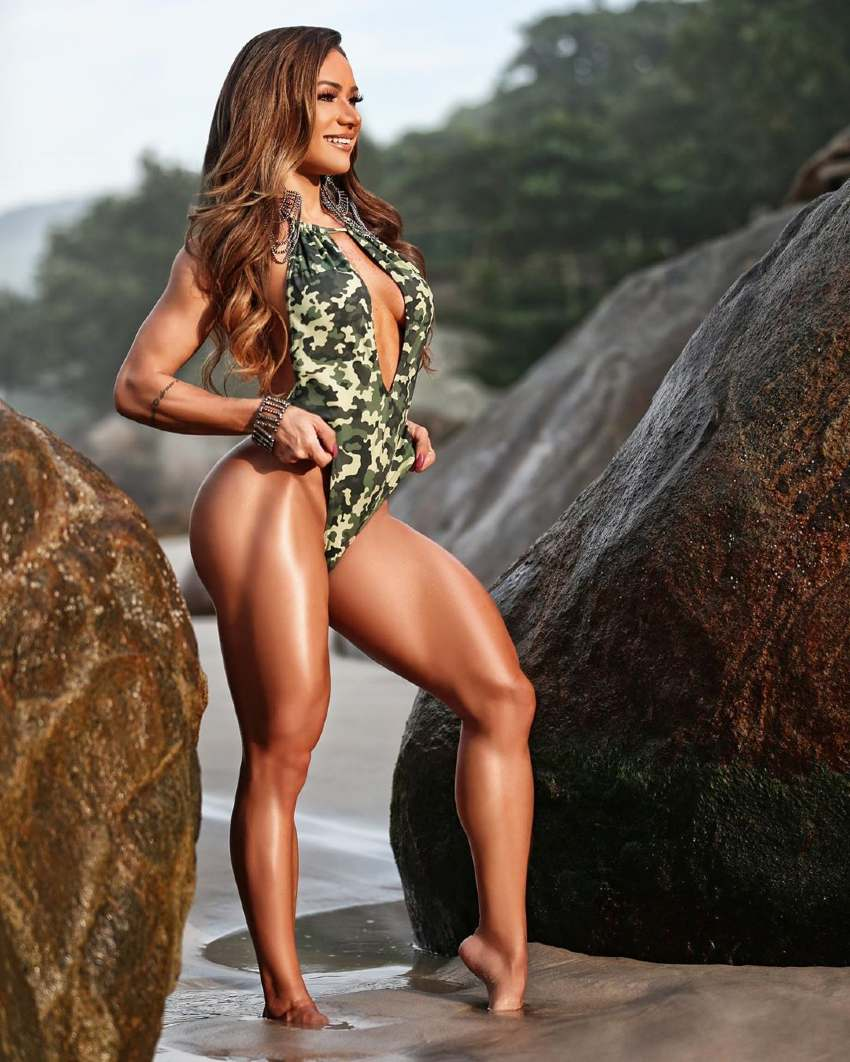 Susana Rodriguez posing in a fitness shoot on the beach