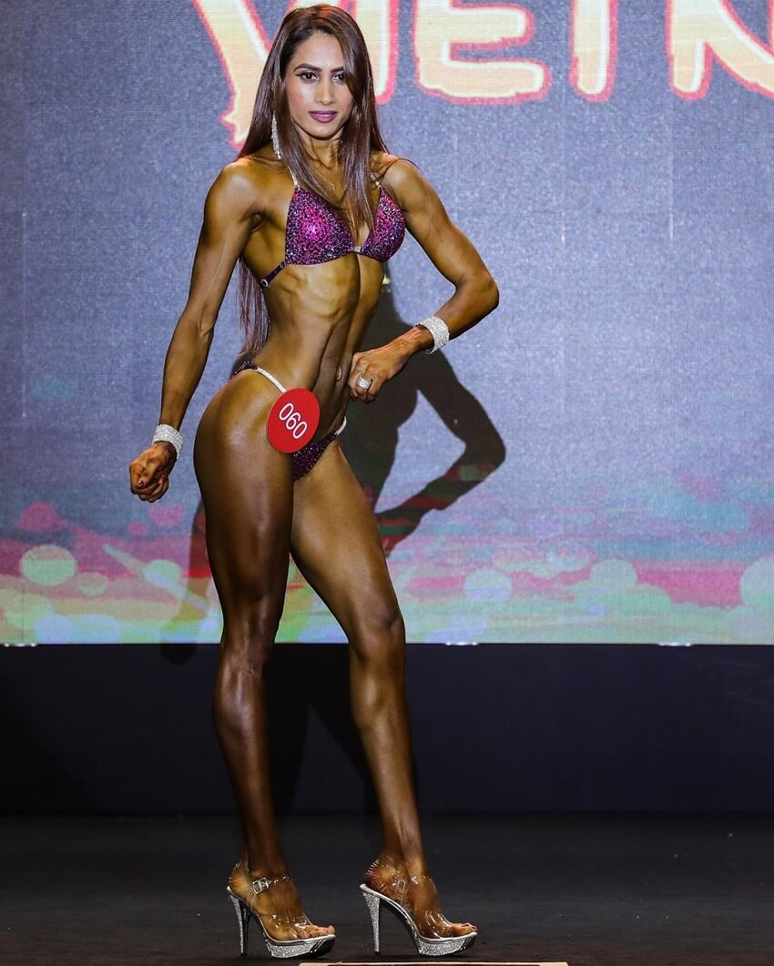 Vaishali Bhoir posing in a fitness bikini competition