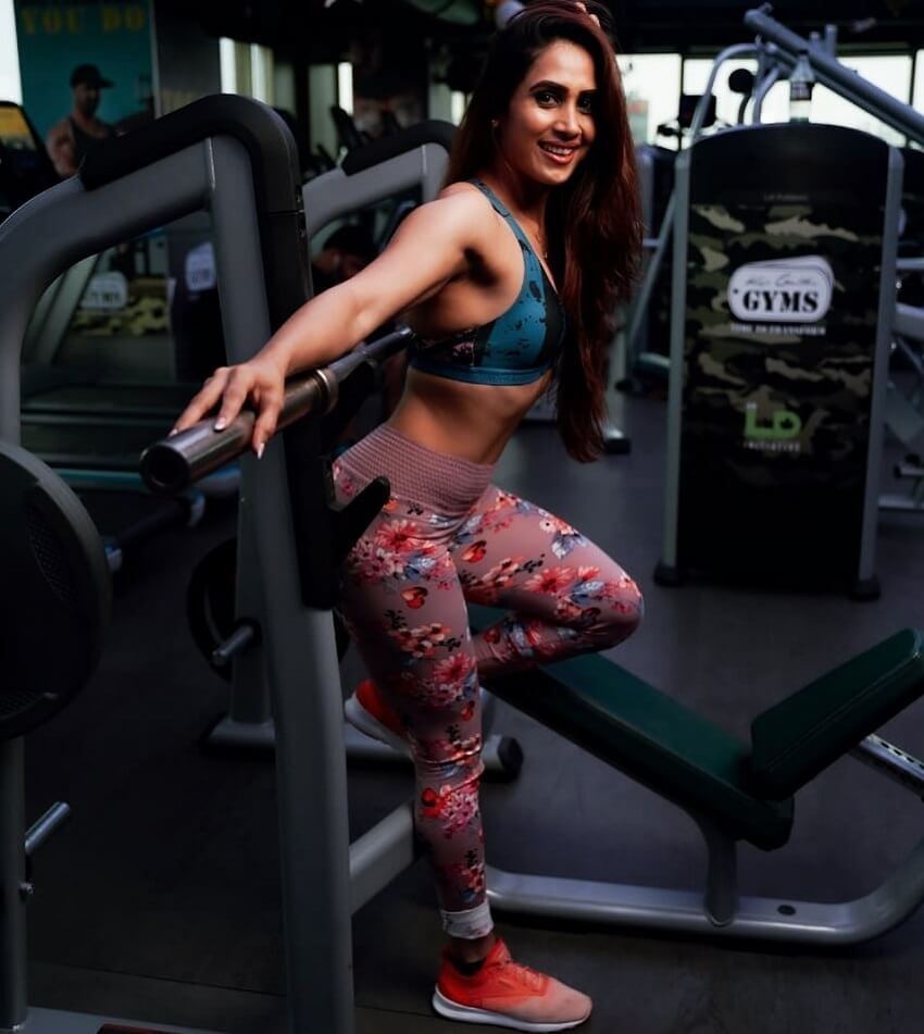 Vaishali Bhoir posing in the gym looking fit and lean