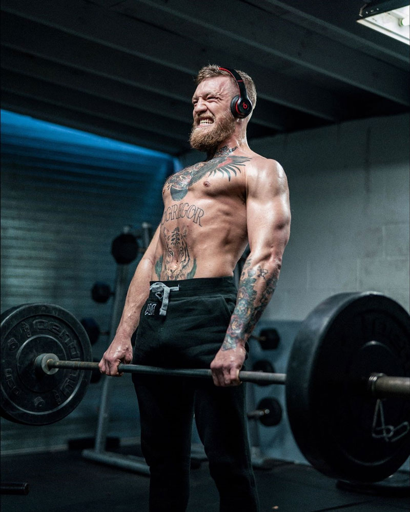 Conor McGregor lifting a barbell